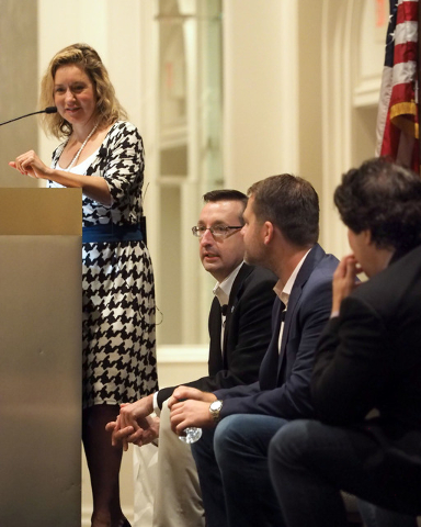 Moderator Shane Tews listens as panelists Michael Kaczmarek, Scott McCormick and Ian C. Ballon, left to right, discuss cyber security details with business owners at a breakfast meeting sponsored  ...