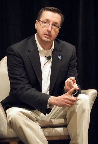 Panelist Michael Kaczmarek discusses cyber security details with business owners at a breakfast meeting sponsored by the Las Vegas Metro Chamber of Commerce in Las Vegas, Friday, July 29, 2016.  J ...