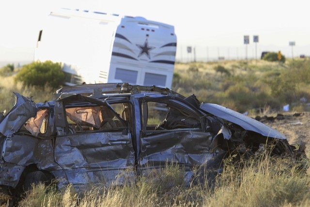 The scene of a fatal crash involving a Dallas Cowboys team bus and a minivan is seen along highway U.S. Highway 93 and Pierce Ferry Road in Dolan Springs, Ariz., on Sunday, July 24, 2016. (Richard ...