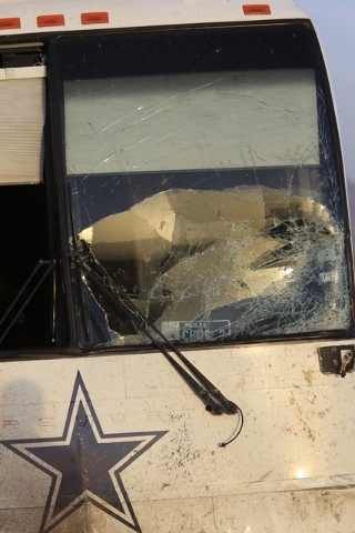 The scene of a fatal crash involving a Dallas Cowboys team bus and a minivan is seen along highway U.S. Highway 93 and Pierce Ferry Road near Dolan Springs, Ariz., on Sunday, July 24, 2016. (Richa ...
