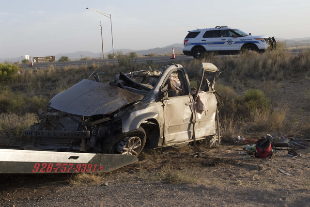 The scene of a fatal crash involving a Dallas Cowboys team bus and a minivan is seen along U.S. Highway 93 and Pierce Ferry Road in Dolan Springs, Ariz., on Sunday, July 24, 2016. (Richard Brian/L ...