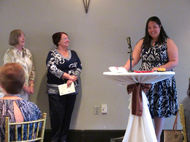 Madison Sandoval-Lunn receives an award from Cam Camburn and Irene O'Rourke at the Women's Club of Summerlin's Dare 2 Dream grants presentation dinner June 21. Special to View