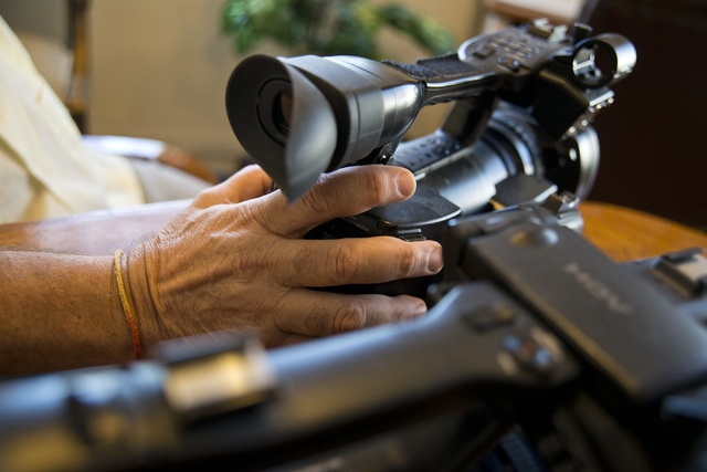Richard Kashanski, a local videographer, places his hand on one of his cameras while speaking with a reporter in his Henderson home on Monday, July 11, 2016. Kashanski is part of a team that has h ...