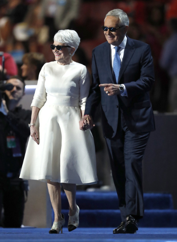 Senate Minority Leader Harry Reid of Nev., is escorted to the podium by wife Landra before speaking during the third day of the Democratic National Convention in Philadelphia , Wednesday, July 27, ...