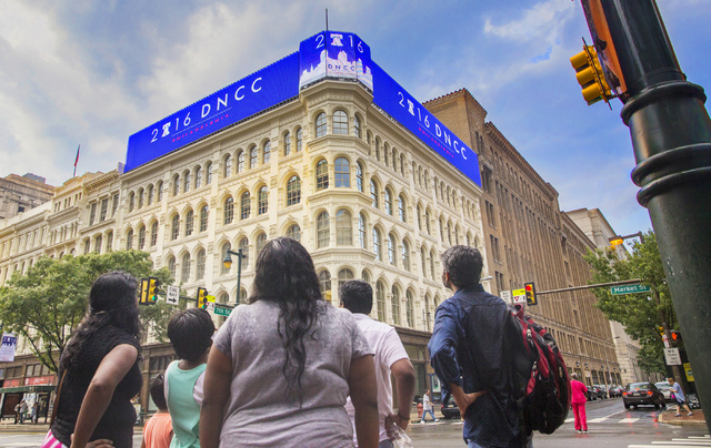 Pedestrians admire a nearly block-long advertisement for the Democratic National Convention in Philadelphia, Pa. (Benjamin Hager/Las Vegas Review-Journal)