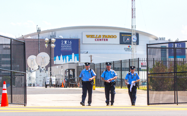 Philadelphia Police Department officers walk the perimeter of the Wells Fargo Center in preparation for the Democratic National Convention on Saturday in Philadelphia, Pa. (Benjamin Hager/Las Vega ...