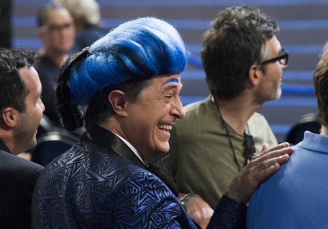 """""""The Late Show"""" host Stephen Colbert, dressed as his version of """"The Hunger Games"""" character Caesar Flickerman, shares a moment with his staff on the eve of the Democratic National Convention at t ..."""