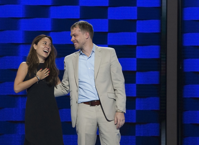 Liz Hart, left, reacts after accepting the surprise wedding proposal of her boyfriend Andrew Binns, right, during rehearsals on the eve of the Democratic National Convention at the Wells Fargo Cen ...