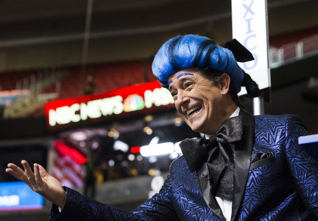 """""""The Late Show"""" host Stephen Colbert, dressed as his version of """"The Hunger Games"""" character Caesar Flickerman, interacts with the crowd on the eve of the Democratic National Convention at the Wel ..."""