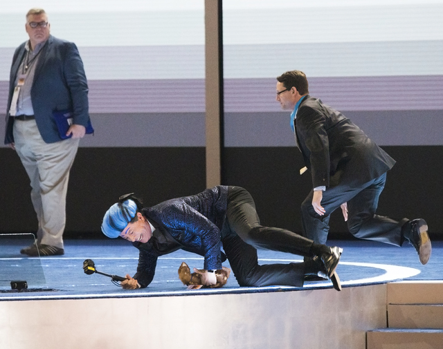 """""""The Late Show"""" host Stephen Colbert, middle, dressed as his version of """"The Hunger Games"""" character Caesar Flickerman, rushes the stage on the eve of the Democratic National Convention at the Wel ..."""