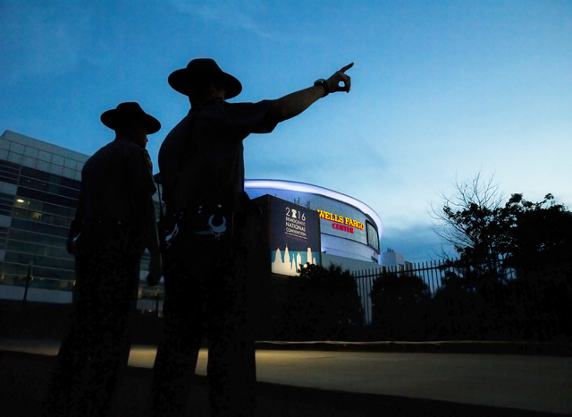 Pennsylvania State Troopers Curwin Walrond, right, and Nathan Grossman patrol the perimeter on the eve of the Democratic National Convention at the Wells Fargo Center on Sunday, July 24, 2016, in  ...