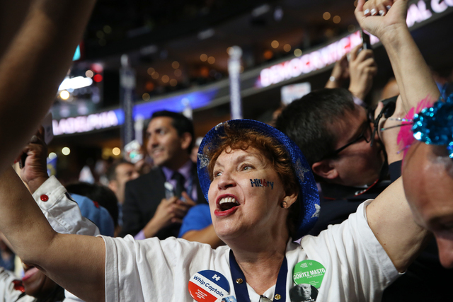Nevada delegate Donna West, of Las Vegas, cheers after Hillary Clinton is officially nominated as the Democratic candidate for president at the Democratic National Convention at the Wells Fargo Ce ...