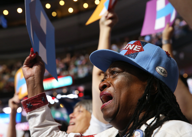 Nevada delegate Jennifer Webb-Cook, of Las Vegas, celebrates with tears in her eyes after Hillary Clinton is officially nominated as the Democratic candidate for president at the Democratic Nation ...