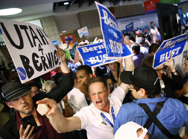 Hundreds of Bernie Sanders supporters angerly walk out of the Wells Fargo Center after Hillary Clinton was officially nominated as the Democratic candidate for president at the Democratic National ...