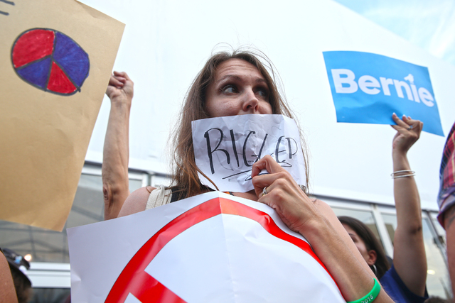 Alison Squires protests outside the Wells Fargo Center with hundreds of Bernie Sanders supporters after Hillary Clinton was officially nominated as the Democratic candidate for president at the De ...
