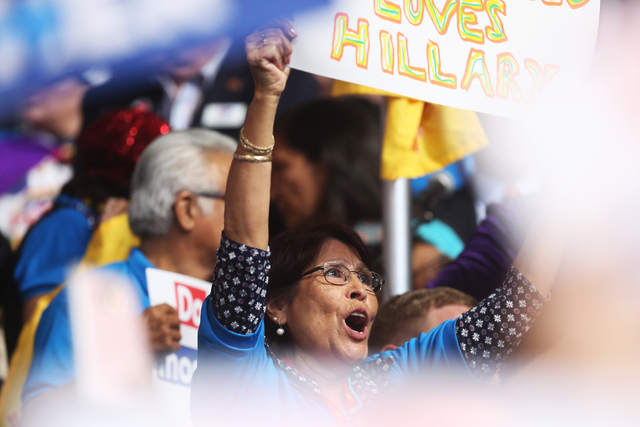 Delegates erupt after Hillary Clinton is officially nominated as the Democratic candidate for president at the Democratic National Convention at the Wells Fargo Center on Tuesday, July 26, 2016, i ...