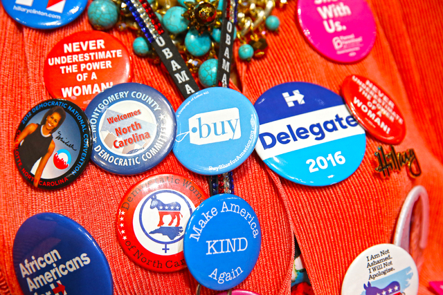 North Carolina delegate Gloria Goodwin dresses in over 20 political buttons on the second day of the Democratic National Convention at the Wells Fargo Center on Tuesday, July 26, 2016, in Philadel ...