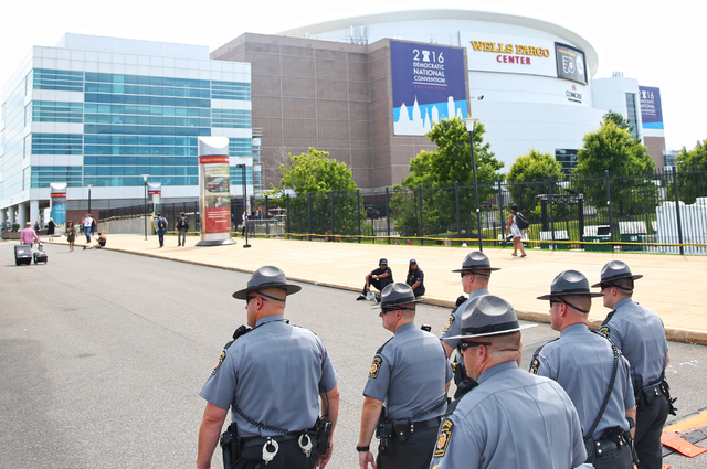 Pennsylvania State Troopers patrol the perimeter of the Wells Fargo Center on the second day of the Democratic National Convention on Tuesday, July 26, 2016, in Philadelphia. (Benjamin Hager/Las V ...