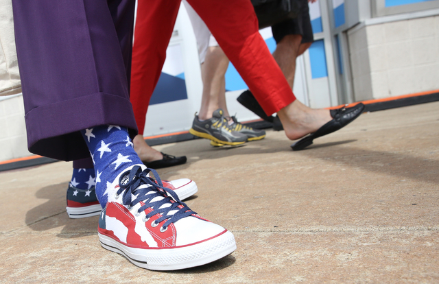 Bishop Rodney McFarland sports red, white and blue Converse sneakers during the second day of the Democratic National Convention at the Wells Fargo Center on Tuesday, July 26, 2016, in Philadelphi ...