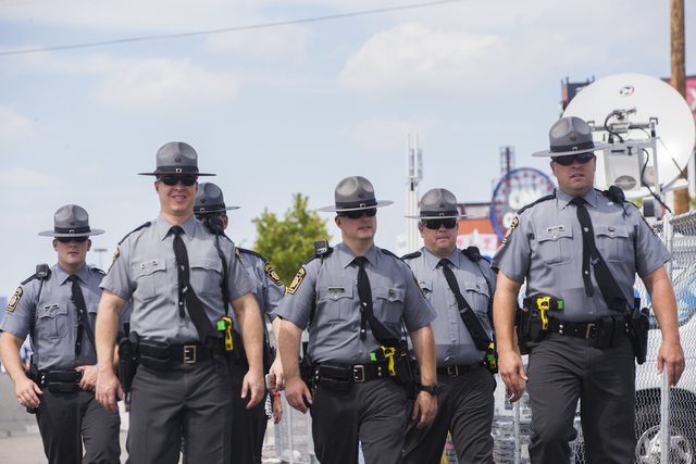 Pennsylvania State Troopers patrol the perimeter of  the Wells Fargo Center on the second day of the Democratic National Convention on Tuesday, July 26, 2016, in Philadelphia. (Benjamin Hager/Las  ...