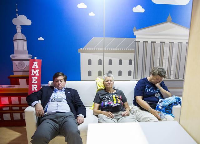 Guests sleep at the Microsoft kiosk before the start of the third day of the Democratic National Convention at the Wells Fargo Center on Wednesday, July 27, 2016, in Philadelphia. Benjamin Hager/L ...