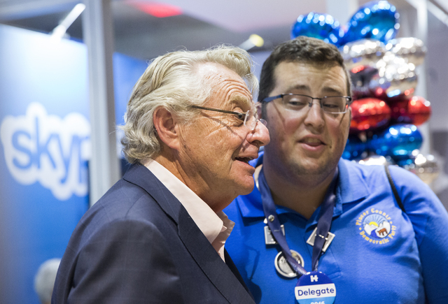 Talk show host Jerry Springer poses for a photo with a fan before the start of the third day of the Democratic National Convention at the Wells Fargo Center on Wednesday, July 27, 2016, in Philade ...