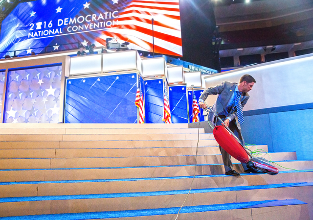 Arthur Canzanese vacuums the podium before the start of the third day of the Democratic National Convention at the Wells Fargo Center on Wednesday, July 27, 2016, in Philadelphia. Benjamin Hager/L ...