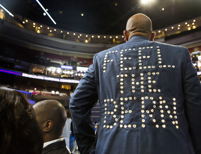 Sanjay Patel shows off his coat supporting Vermont Senator Bernie Sanders before the start of the third day of the Democratic National Convention at the Wells Fargo Center on Wednesday, July 27, 2 ...