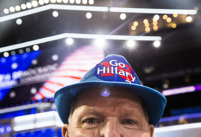 Hillary Clinton supporter Tom Garner poses for a photo before the start of the third day of the Democratic National Convention at the Wells Fargo Center on Wednesday, July 27, 2016, in Philadelphi ...