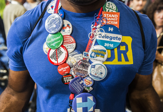 Travis Nelson shows off his political swag before the start of the third day of the Democratic National Convention at the Wells Fargo Center on Wednesday, July 27, 2016, in Philadelphia. Benjamin  ...