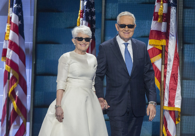 Senate Minority Leader Harry Reid and wife Landra walk onto the podium during the third day of the Democratic National Convention at the Wells Fargo Center on Wednesday, July 27, 2016, in Philadel ...