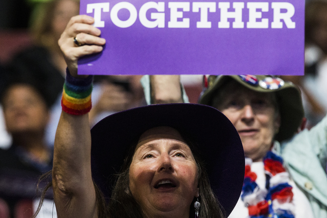 Sonya Jaquez Lewis cheers for Senate Minority Leader Harry Reid during the third day of the Democratic National Convention at the Wells Fargo Center on Wednesday, July 27, 2016, in Philadelphia. B ...