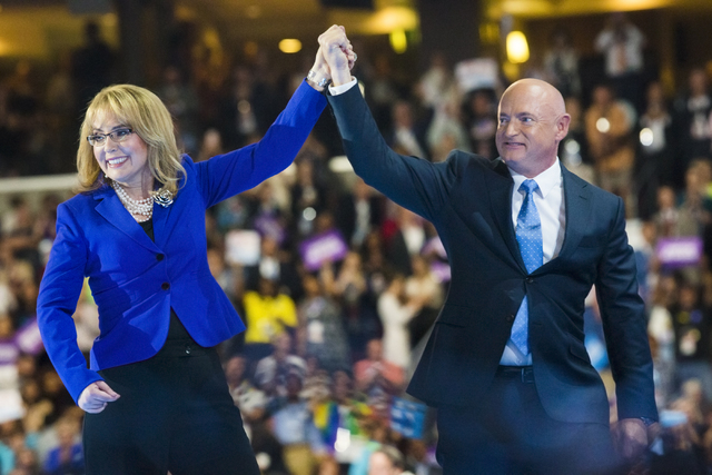 Retired NASA astronaut Mark Kelly and his wife, former Arizona congresswoman Gabrielle Giffords, walk off the stage during the third day of the Democratic National Convention at the Wells Fargo Ce ...