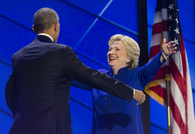 President Barack Obama, left, hugs Hillary Clinton at the conclusion of the third day of the Democratic National Convention at the Wells Fargo Center on Wednesday, July 27, 2016, in Philadelphia.  ...