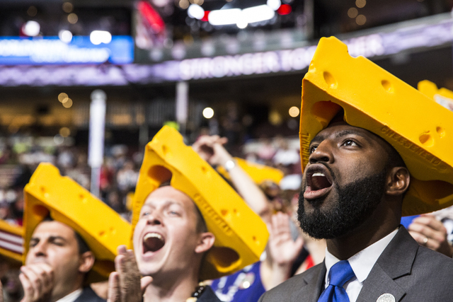 David Bowen, right, celebrates with fellow delegates from Wisconsin during the final day of the Democratic National Convention at the Wells Fargo Center on Thursday, July 28, 2016, in Philadelphia ...
