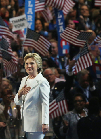 Democratic presidential nominee Hillary Clinton salutes the crowd during the final day of the Democratic National Convention at the Wells Fargo Center on Thursday, July 28, 2016, in Philadelphia.  ...