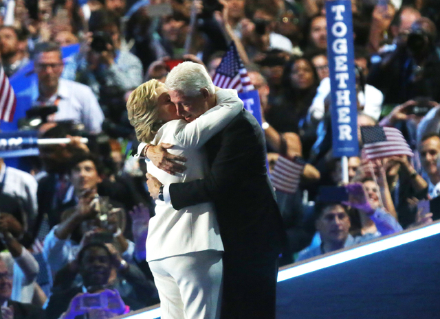 Democratic presidential nominee Hillary Clinton, left, hugs husband former President Bill Clinton during the final day of the Democratic National Convention at the Wells Fargo Center on Thursday,  ...