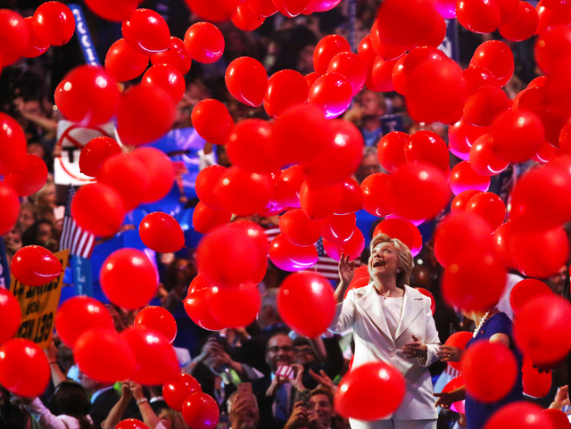 Democratic presidential nominee Hillary Clinton walks off stage through a sea of balloons during the final day of the Democratic National Convention at the Wells Fargo Center on Thursday, July 28, ...