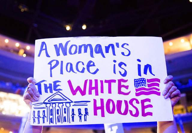 Bobbie Singh-Allen holds up a sign supporting Democratic presidential nominee Hillary Clinton during the final day of the Democratic National Convention at the Wells Fargo Center on Thursday, July ...