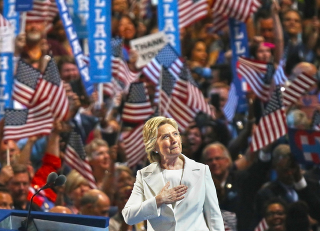 Democratic presidential nominee Hillary Clinton looks into the crowd before presenting her speech during the final day of the Democratic National Convention at the Wells Fargo Center on Thursday,  ...
