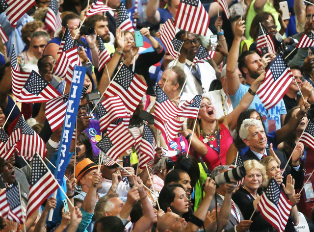 The crowd erupts as Democratic presidential nominee Hillary Clinton walks on stage during the final day of the Democratic National Convention at the Wells Fargo Center on Thursday, July 28, 2016,  ...