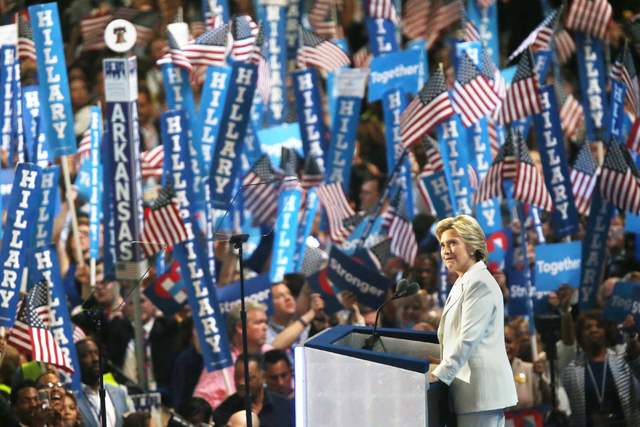 Democratic presidential nominee Hillary Clinton looks into the crowd while presenting her speech during the final day of the Democratic National Convention at the Wells Fargo Center on Thursday, J ...