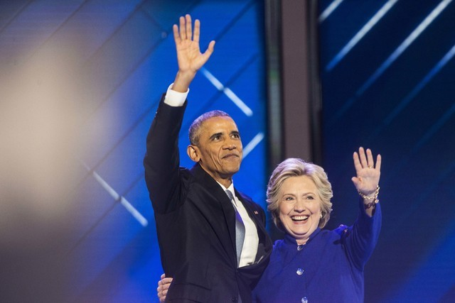 President Barack Obama celebrates with Hillary Clinton at the conclusion of the third day of the Democratic National Convention at the Wells Fargo Center on Wednesday, July 27, 2016, in Philadelph ...