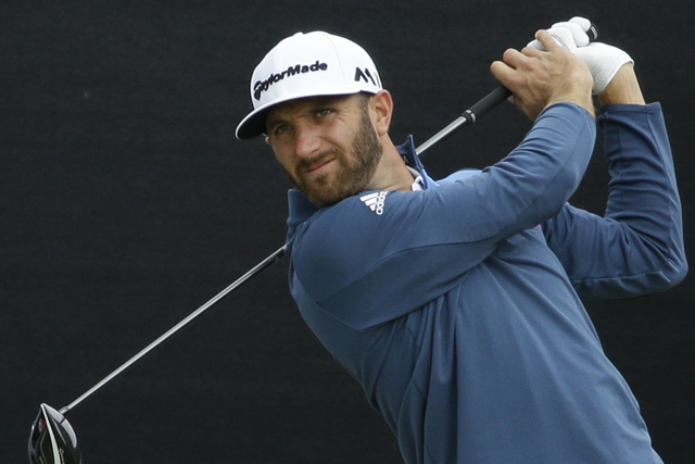 Dustin Johnson of the US plays his tee shot off the 1st during a practice round ahead of the British Open Golf Championships at the Royal Troon Golf Club in Troon, Scotland, Tuesday, July 12, 2016 ...