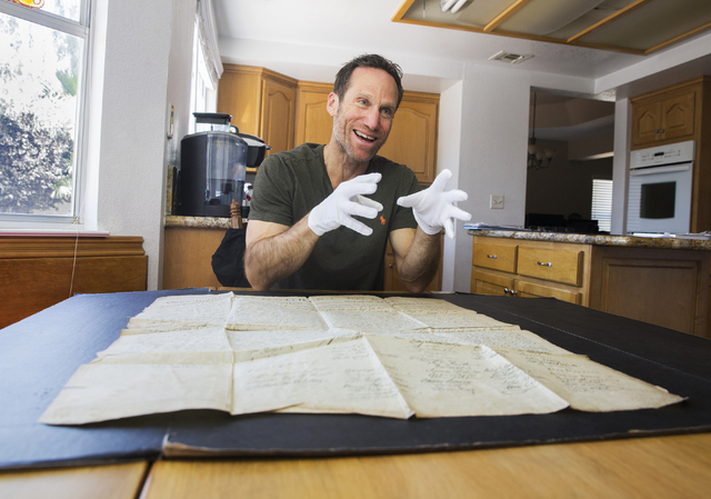 Kevin Kostiner discusses discovering a second-generation copy of the Declaration of Independence in a box of documents purchased at an online auction on Wednesday, June 22, 2016, at his home in He ...