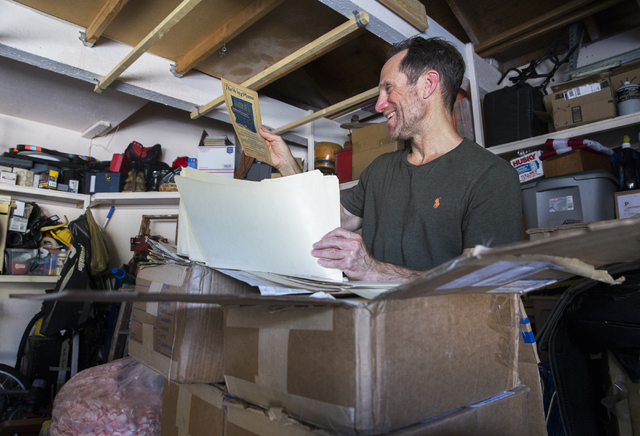Kevin Kostiner looks through the box of documents he purchased at an online auction that contained a second-generation copy of the Declaration of Independence on Wednesday, June 22, 2016, at his h ...