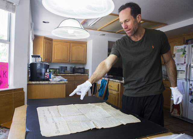 Kevin Kostiner discusses the dye used to print the second-generation copy of the Declaration of Independence he found in a box of documents purchased at an online auction on Wednesday, June 22, 20 ...