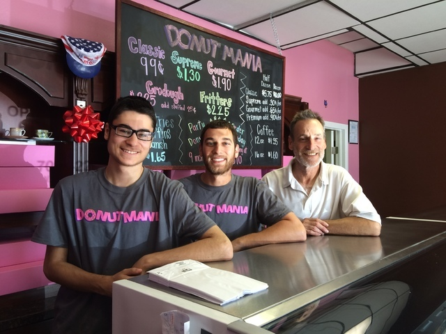 The Linsk family takes a break from making doughnuts June 28 at Donut Mania, 4460 S. Durango Drive. From left are Tyler and Steve and their father, Wayne. Wayne spent much of his career setting up ...