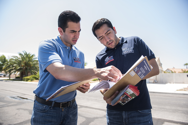 Democrats Nevada Sen. Ruben Kihuen, left, and Nevada Assemblyman Nelson Araujo check addresses in a Las Vegas neighborhood while canvassing for votes on June 11, 2016. Kihuen is running for U.S. C ...
