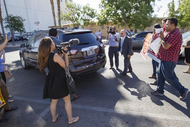 Protesters heckle U.S. Representative U.S. Rep. Joe Heck, R-Nev., as he drives away following a breakfast meeting hosted by the non-partisan organization Hispanics In Politics. (Richard Brian/Las  ...